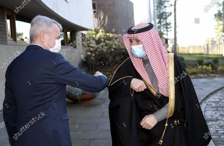 Finnish Foreign Minister Pekka Haavisto (L) greets Saudi Minister of State for Foreign Affairs Adel al-Jubeir, both wearing masks due to the COVID-19 novel coronavirus pandemic, as they meet in Helsinki, Finland, on November 9, 2020.