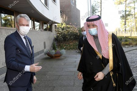 Stock Photo of Finnish Foreign Minister Pekka Haavisto (L) greets Saudi Minister of State for Foreign Affairs Adel al-Jubeir, both wearing masks due to the COVID-19 novel coronavirus pandemic, as they meet in Helsinki, Finland, on November 9, 2020.