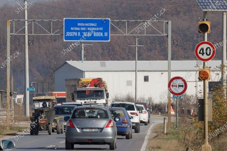 Stock Picture of Cars drive along the national road named after elected US President Joe Biden late son, Joseph R. 'Beau' Biden III, near the US military Camp Bondsteel, in the village of Sojevo, Kosovo, 09 November 2020.