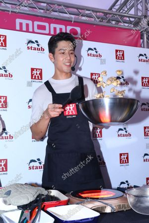 Stock Photo of George Hu attends the momo 1111 brand carnival and promotes a brand German kitchen utensils
