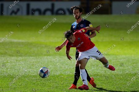 Stock Image of Jimmy Keohane of Rochdale AFC and Dan Hawkins of Salford City