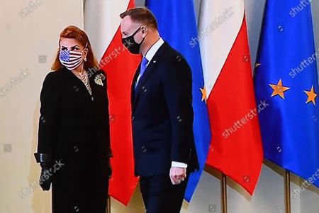 Stock Image of A television screen shows Polish President Andrzej Duda (R) and US Ambassador to Poland Georgette Mosbacher (L)  during the ratifying of the Polish-US Enhanced Defense Cooperation Agreement that will lead to an increase in the United States military presence in Poland, at the Presidential Palace in Warsaw, Poland, 09 November 2020. Under the agreement it will be possible, in the event of a possible threat, to immediately deploy additional forces to Poland, ensuring a total presence of up to 20,000 US troops.