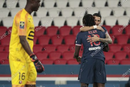 Stock Photo of Bioty Moise Kean (PSG) scored a goal, celebration in arms of Angel Di Maria (PSG), Amigo Alfred Junior Gomis (Stade Rennais)