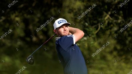 Tyrrell Hatton watches his tee shot on the first hole during the first round of the Houston Open golf tournament, in Houston