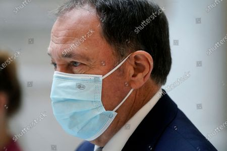 Utah Gov. Gary Herbert walks through the Capitol rotunda to a COVID-19 briefing, in Salt Lake City. Herbert declared a state of emergency Sunday night, Nov. 8 and ordered a statewide mask mandate in an attempt to stem a surge in coronavirus patient hospitalizations that is testing the state's hospital capacity