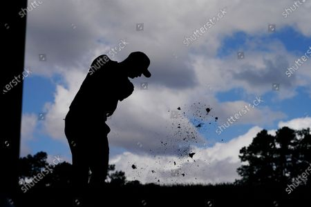 Justin Rose, of England, tees off on the 16th hole during a practice round for the Masters golf tournament, in Augusta, Ga