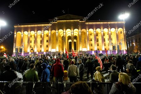 Demonstrators gather during a rally of supporters of the ex-President Mikhail Saakashvili's United National Movement, protesting the election results in Tbilisi, Georgia, . Some thousands of opposition supporters rallied Monday in ex-Soviet Georgia to demand a snap vote after the opposition accused the ruling party of rigging tightly contested parliamentary elections