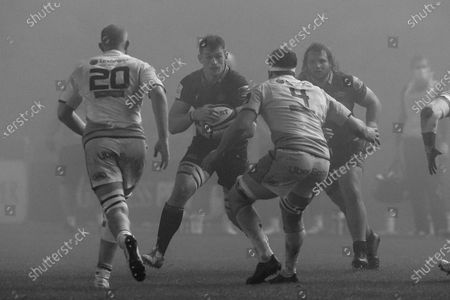 Magnus Bradbury (#6) of Edinburgh Rugby charges through the fog toward Sam Moore (#20) and James Ratti (#4) of Cardiff Blues during the Guinness Pro 14 match between Edinburgh Rugby and Cardiff Blues at BT Murrayfield, Edinburgh