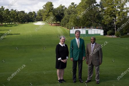 Stock Picture of Lee Elder, right, Fred Ridley, Chairman of Augusta National Golf Club, and Sharon Elder posed for a picture on the first tee at the Masters golf tournament, in Augusta, Ga. Ridley, announced today that Lee Elder, the first Black man to compete in the Masters Tournament 45 years ago, will be honored by establishing scholarships in his name and inviting him to be an Honorary Starter for the 2021 Masters