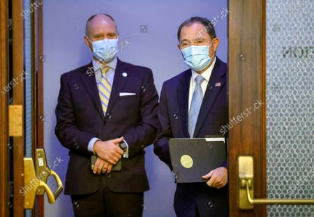 Chief of Staff Justin Harding, left, stands behind Utah Gov. Gary Herbert before a press conference at the Capitol in Salt Lake City, clarifying the state's mask mandate on