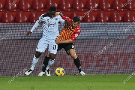 Emmanuel Gyasi (Spezia Calcio) and Christian Maggio (Benevento Calcio)