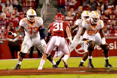 Tennessee offensive lineman Trey Smith (73) and Wanya Morris (64) block against Arkansas during an NCAA college football game, in Fayetteville, Ark