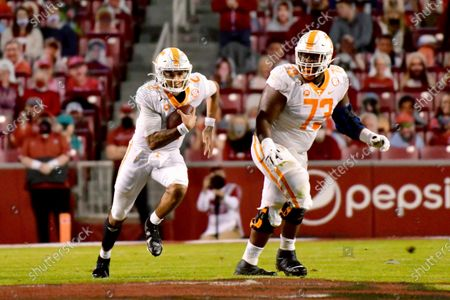 Tennessee offensive lineman Trey Smith (73) blocks for quarterback Jarrett Guarantano (2) as they run a play against Arkansas during an NCAA college football game, in Fayetteville, Ark