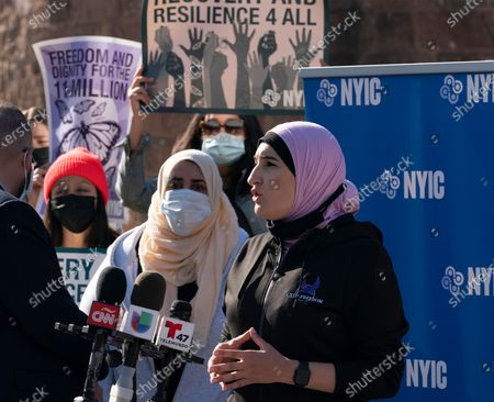 Political activist Linda Sarsour speaks at a rally asking President-elect Joe Biden to prioritize immigration reform, in New York