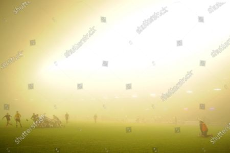 Jamie Hill of Cardiff passes from a scrum as dense fog covers the pitch in the second half.