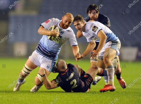 Stock Photo of Sam Moore of Cardiff tackled by Dave Cherry of Edinburgh