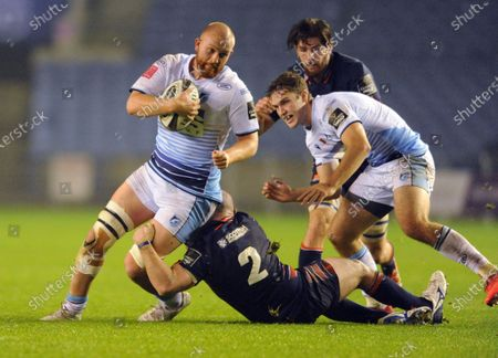 Sam Moore of Cardiff tackled by Dave Cherry of Edinburgh
