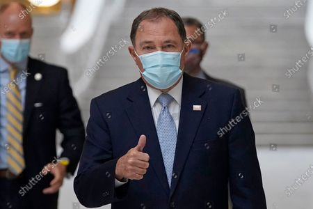 Stock Image of Utah Gov. Gary Herbert gives a thumbs up as he walks through the Capitol rotunda to a COVID-19 briefing, in Salt Lake City. Herbert ordered a statewide mask mandate for the first time late Sunday. He is also pausing extracurricular school activities, along with most sports and social gatherings with people outside the household