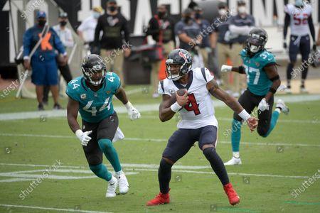 Houston Texans quarterback Deshaun Watson (4) scrambles for yardage in front of Jacksonville Jaguars linebacker Myles Jack (44) during the first half of an NFL football game, in Jacksonville, Fla