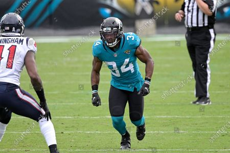 Jacksonville Jaguars running back Chris Thompson (34) runs a route in front of Houston Texans linebacker Zach Cunningham (41) during the second half of an NFL football game, in Jacksonville, Fla
