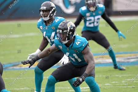 Jacksonville Jaguars linebacker Josh Allen (41) and linebacker Myles Jack (44) follow a play during the second half of an NFL football game against the Houston Texans, in Jacksonville, Fla