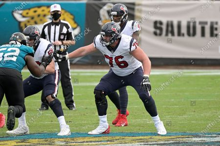 Houston Texans offensive tackle Brent Qvale (76) and center Nick Martin (66) set up to block in front of Jacksonville Jaguars defensive tackle DaVon Hamilton (52) during the second half of an NFL football game, in Jacksonville, Fla