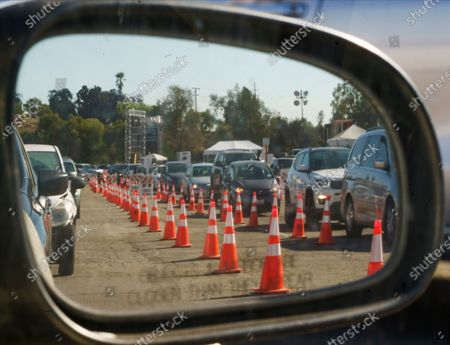 Drivers with an appointment wait in line to get a free of charge COVID-19 virus self-test at Dodger Stadium, with the capacity to test 6,000 Angelenos a day in Los Angeles on . Testing company Curative and Sean Penn's non-profit, Community Organized Relief Effort: CORE Response, are stepping up to meet increased demand by providing free COVID-19 testing throughout California, in partnership with local governments and community-based organizations
