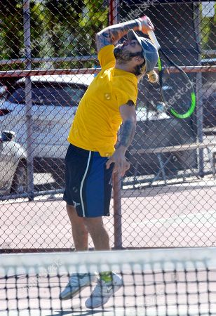 Stock Image of Exclusive - Pete Wentz plays tennis at a park in Studio City