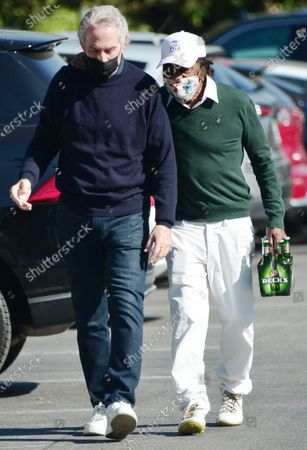 Exclusive - Johnny Mathis is seen going for a walk with a friend in West Hollywood