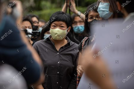 Radio Television Hong Kong reporter Bao Choy Yuk-ling (C) arrives at the Fanling Magistrates' Courts in Hong Kong, China, 10 November 2020. Choy has been charged with making false statements under the Road Traffic Ordinance when she was tracing those behind the vicious mob attack in Yuen Long on July 21 last year. Choy was released on bail.