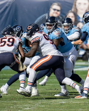 Tennessee Titans offensive guard Rodger Saffold III (76), blocks Chicago Bears defensive tackle Bilal Nichols (98), during an NFL football game, in Nashville, Tenn