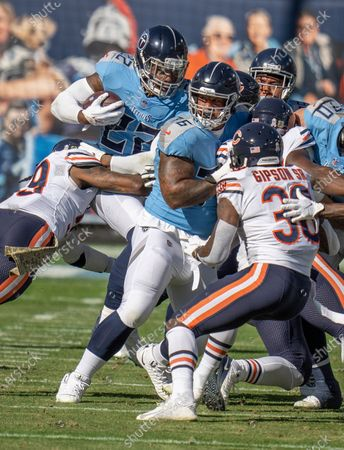 Stock Photo of Tennessee Titans running back Derrick Henry (22) follows the blocking of Rodger Saffold III (76), but he is brought down by Chicago Bears linebacker Danny Trevathan (59) during an NFL football game, in Nashville, Tenn