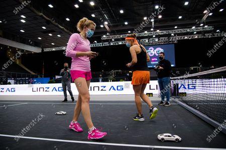 Katerina Siniakova & Lucie Hradecka of the Czech Republic playing with the Porsche Taycan RC car at the 2020 Upper Austria Ladies Linz WTA International tennis tournament