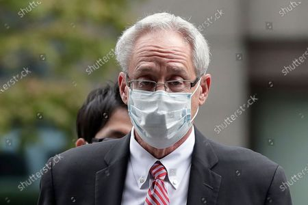 Former Nissan Motor Co. executive Greg Kelly arrives for the first trial hearing at the Tokyo District Court in Tokyo. The defense for Kelly began its cross-examination, asserting innocence, in a Japanese criminal trial over the alleged under-reporting of former Chairman Carlos Ghosn's pay