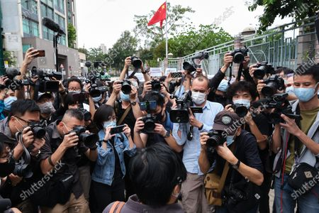 Members of the press take photographs of Bao Choy-yuk Ling, a freelance journalist as she arrives at the Fanling Magistrates' Court for the hearing. Bao Choy-yuk Ling, a freelance journalist who worked with Hong Kong's public broadcaster RTHK (Radio Television Hong Kong) on investigations into the July 21 Yuen Long mob attack, arrives wearing a facemask at Fanling Magistrates' Court for a hearing. Choy was arrested for making a false statement related to her investigation into suspected persons involved in the Yuen Long mob attack for a RTHK TV documentary.