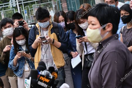 Members of the media wearing facemasks, listen as Bao Choy-yuk Ling, a freelance journalist as she addresses them on her arrival at Fanling Magistrates' Court for a hearing. Bao Choy-yuk Ling, a freelance journalist who worked with Hong Kong's public broadcaster RTHK (Radio Television Hong Kong) on investigations into the July 21 Yuen Long mob attack, arrives wearing a facemask at Fanling Magistrates' Court for a hearing. Choy was arrested for making a false statement related to her investigation into suspected persons involved in the Yuen Long mob attack for a RTHK TV documentary.
