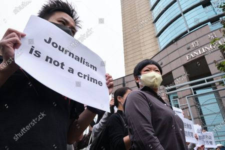 """Supporters of Bao Choy-yuk Ling, a freelance journalist display placards  reading """"Journalism is not a crime."""" outside the Fanling Magistrates' Court. Bao Choy-yuk Ling, a freelance journalist who worked with Hong Kong's public broadcaster RTHK (Radio Television Hong Kong) on investigations into the July 21 Yuen Long mob attack, arrives wearing a facemask at Fanling Magistrates' Court for a hearing. Choy was arrested for making a false statement related to her investigation into suspected persons involved in the Yuen Long mob attack for a RTHK TV documentary."""