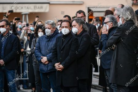Stock Picture of Funeral of Stefano D'Orazio, the keyboard player of the Pooh Roby Facchinetti and the singer Red Canzian