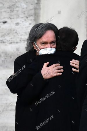 Funeral of Stefano D'Orazio, the singer of the Pooh Red Canzian hugs the keyboard player Roby Facchinetti