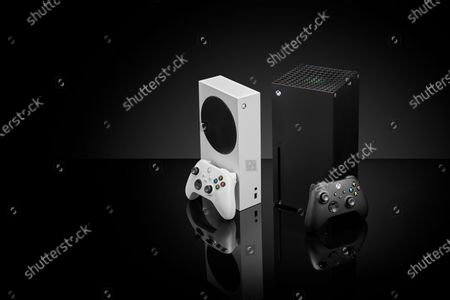 Stock Picture of A pair of Microsoft home video game consoles, including an Xbox Series S (L) and Xbox Series X, taken on October 27, 2020. (Photo by Phil Barker/Future Publishing)