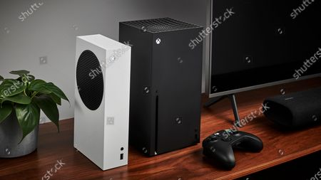 Stock Photo of Living room with a pair of Microsoft home video game consoles, including an Xbox Series S (L) and Xbox Series X, alongside a television and soundbar, taken on October 27, 2020. (Photo by Phil Barker/Future Publishing)