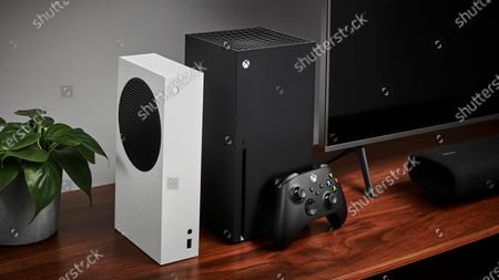 Living room with a pair of Microsoft home video game consoles, including an Xbox Series S (L) and Xbox Series X, alongside a television and soundbar, taken on October 27, 2020. (Photo by Phil Barker/Future Publishing)