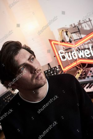 Portrait of Scottish musician Sam McTrusty, guitarist and vocalist with alternative rock group Twin Atlantic, photographed at the band's studio in Glasgow, Scotland, on December 4, 2019. (Photo by Joseph Branston/Future Music Magazine)