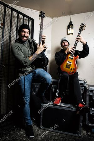 Portrait of American musicians Clint Lowery (L) and John Connelly, guitarists with hard rock group Sevendust, photographed backstage before a live performance at the Electric Ballroom in London, on December 2, 2018. (Photo by Will Ireland/Total Guitar Magazine)