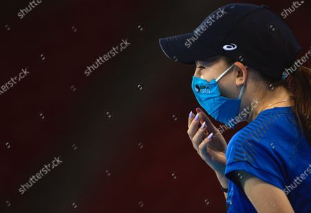 A ball girl wears a protective face mask during the first round match between Roberto Carballes Baena of Spain and Richard Gasquet of France at the Sofia Open ATP 250 tennis tournament in Sofia, Bulgaria, 10 November 2020.