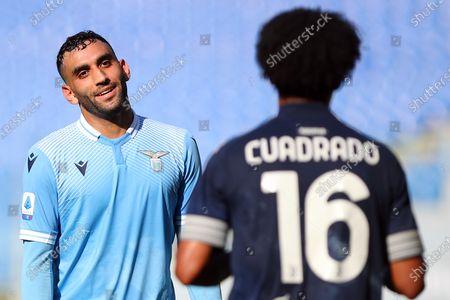 Mohamed Fares (Lazio)  Juan Cuadrado (Juventus) during the match