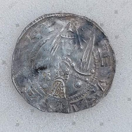 The silver penny of Baron Eustace Fitzjohn.   An incredibly rare 900-year-old coin unearthed by an amateur detectorist has sold for almost £30,000.  The silver penny of Baron Eustace Fitzjohn, a 12th century business magnate who was the Alan Sugar of his day, was dug up by Rob Brown.  The 56-year-old was hunting for treasure on a stubble field near Pickering in North Yorkshire when he found the valuable piece.   It was the first item he found that day and was buried just two inches below the ground.  Mr Brown notified his local finds liaison officer about the discovery and then sent specialist auctioneers Dix Noonan Webb, of London, a photo of the coin. An excited expert immediately caught a train from London to Leeds to meet with him. The coin fetched double its estimate, with the buyer paying £29,760 including fees.