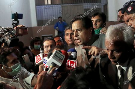 Mohammad Safdar, center, son-in-law of exiled former Pakistani Prime Minister Nawaz Sharif, gestures as he speaks to journalists after a court granted him bail, outside a court in Karachi, Pakistan. Pakistan's military Tuesday announced the suspension of an unspecified number of intelligence officers and troops accused last month by opposition leaders of abducting a provincial police chief to pressure him to arrest Safdar. Nawaz Sharif