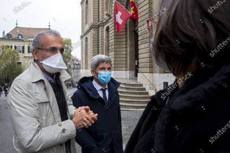 Swiss leading Islamic scholar Tariq Ramadan (L) with his Swiss lawyers Guerric Canonica (C) and Yael Hayat leaves the Geneva's courthouse after a first hearing with Geneva's prosecutor as part of an investigation over sexual assault, in Geneva, Switzerland, 10 November 2020. This is the first time the Islamologist leaves France since he was indicted in Paris on February 2018. His judicial supervision, which prohibited him from travelling outside France, was amended last month to allow him to take part in the hearing in Geneva.