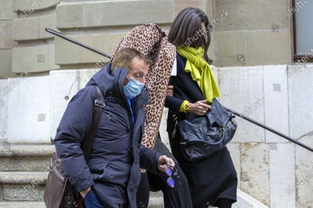 Stock Image of Brigitte (face behind her coat), one of the alleged victim of Swiss leading Islamic scholar Tariq Ramadan leaves Geneva's courthouse with his Swiss lawyer Robert Assael (L) after a first hearing with Geneva's prosecutor as part of an investigation over sexual assault, in Geneva, Switzerland, 10 November 2020. It is the first time the Islamologist leaves France since he was indicted in Paris on February 2018. His judicial supervision, which prohibited him from travelling outside France, was amended last month to allow him to take part in the hearing in Geneva.